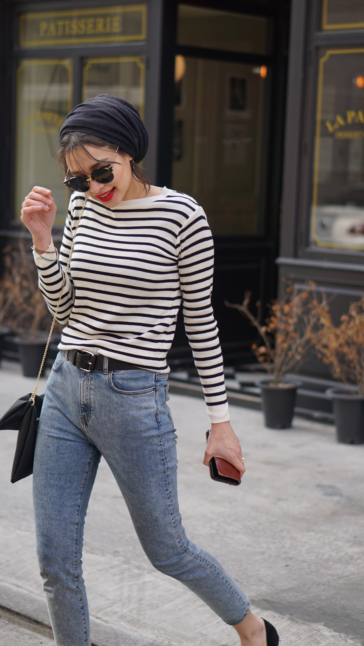 French_outfit_woman_crossing_street_breton_stripe_top_blue_jeans_red_lips