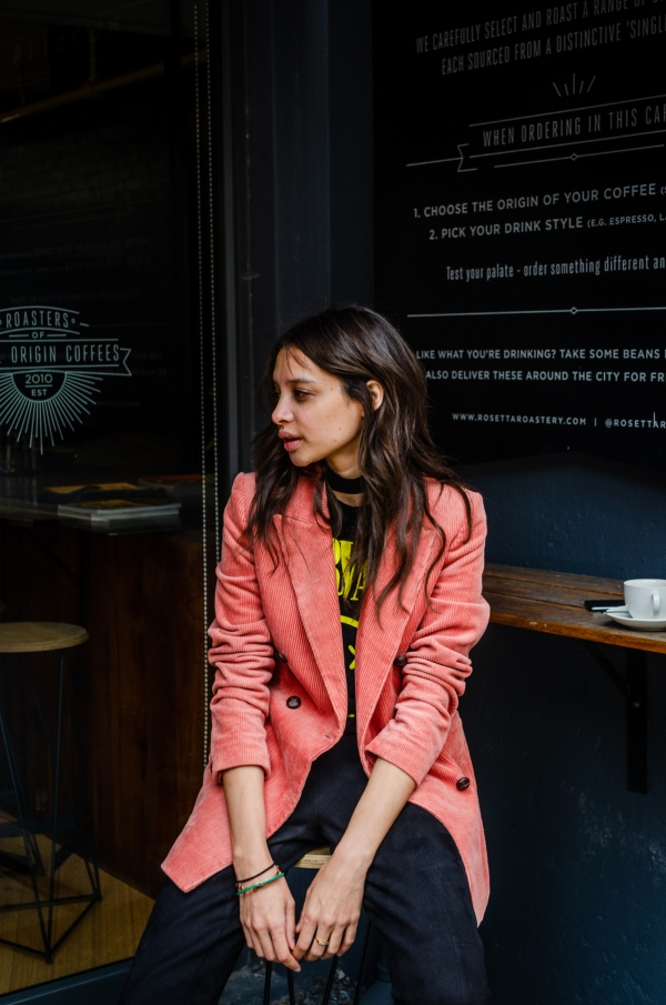 woman_in_pink_blazer_sitting_at_coffee_shop_cape_town